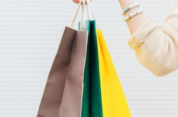 Closeup of young woman with shopping bags